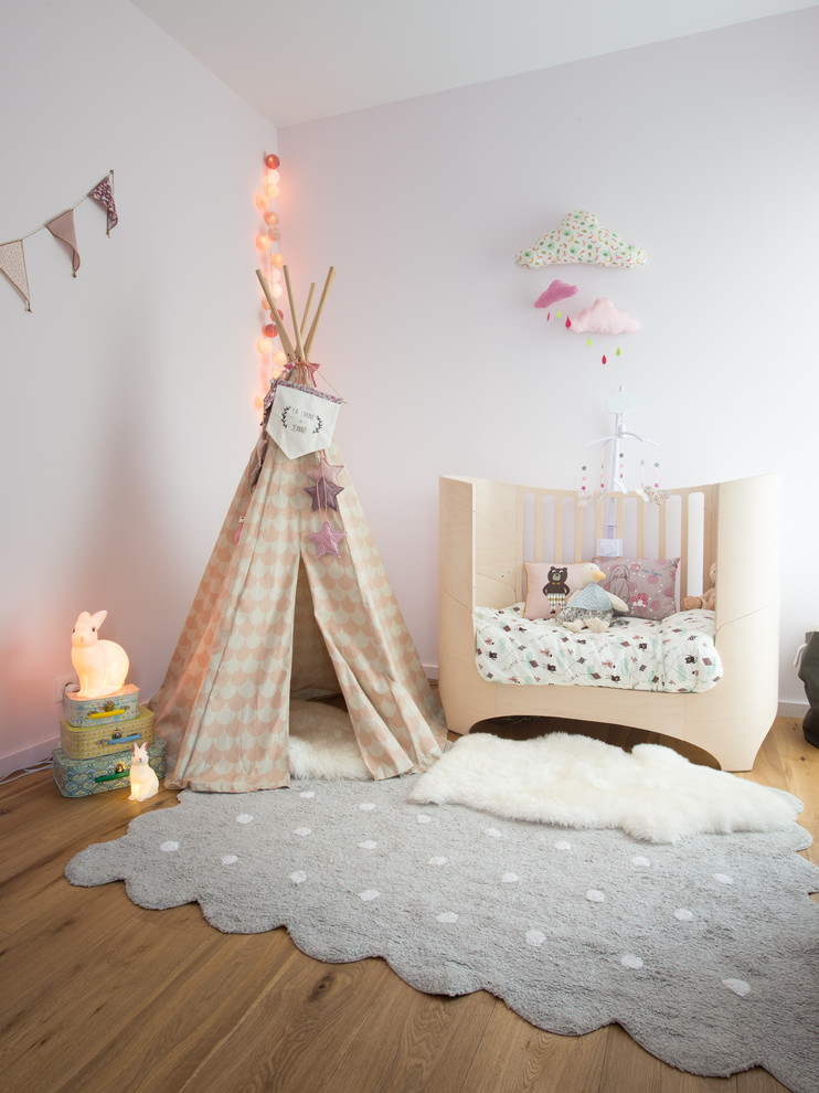 adorable nursery idea fluffy white shag rug in small size grey rug with white polka dots light cream crib decorative kids' tent medium toned wood floors white walls