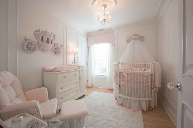 baby girl nursery idea fluffy white rug medium toned wood floors baby pink nursery chair and table round white crib with baby pink skirt white changing table with baby pink mattress