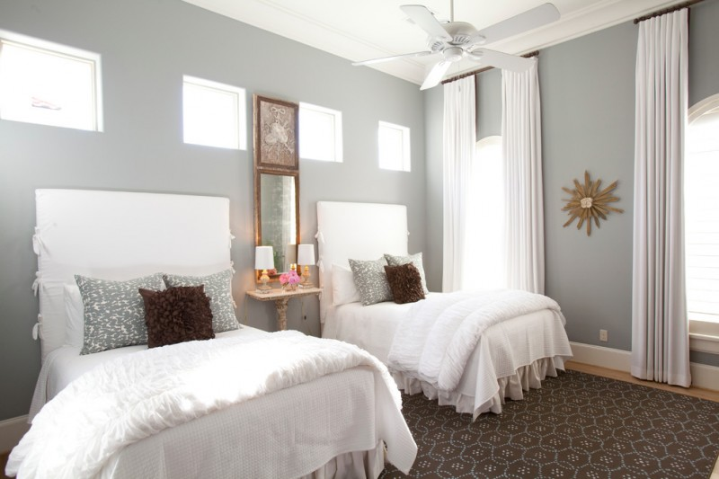basement bedroom for girls idea white basement window curtains with dark rod light grey walls white trimmed windows traditional bed frames with white headboards dark brown carpet with white motifs