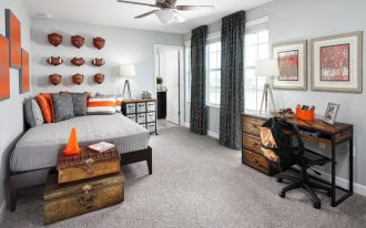 basement boys' bedroom with little rustic feel rustic studying table black working chair with wheels grey carpet light grey walls artistic wall arts floor to ceiling window curtains in black rustic dr