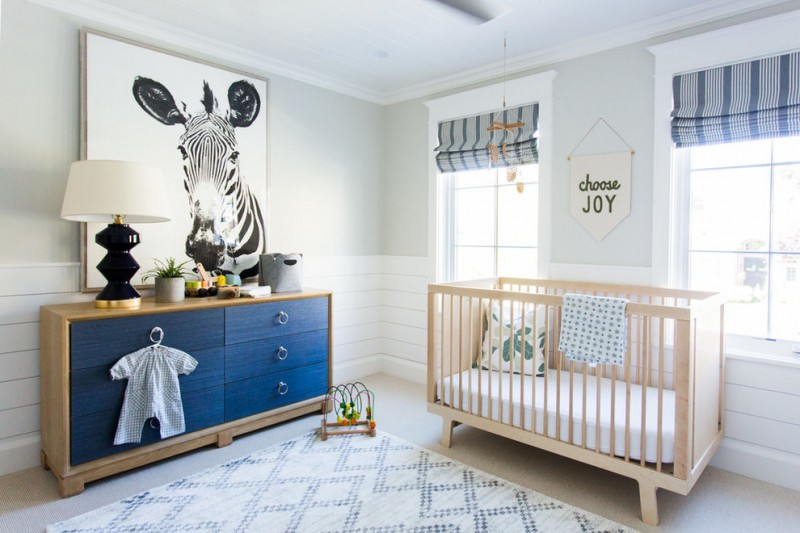 beach style nursery idea light toned wood crib wood framed changing table with ivory painted surface light rug with light ivory accents
