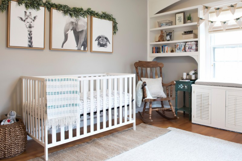 chic baby nursery idea white rug dark cream secondary rug new style baby crib in white hardwood rocking chair with accent pillow dark toned wood floors basket for storage light grey walls