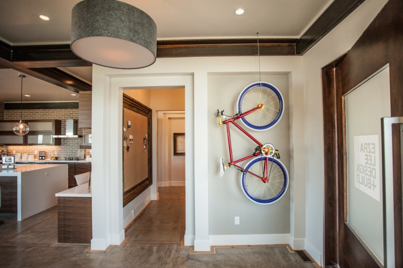 contemporary entrance hall idea with stunning decorative bike hanging on ceilings