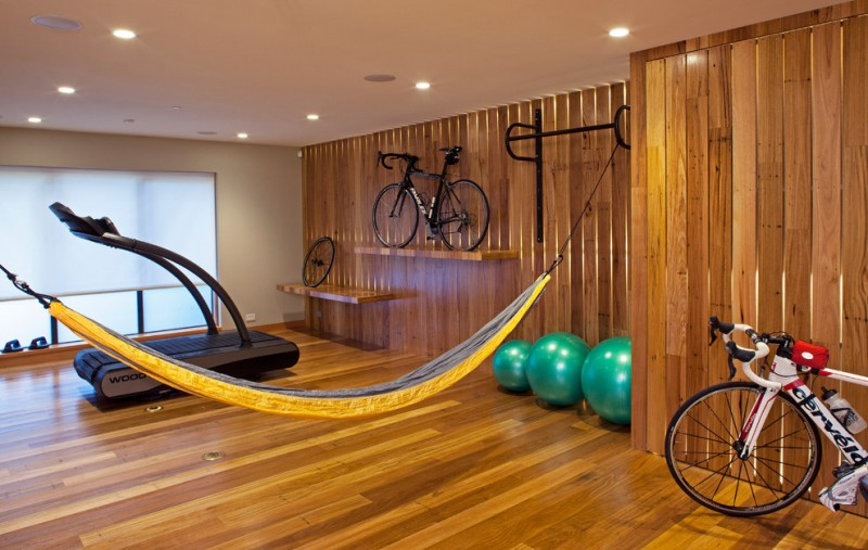 contemporary gym home wood board walls with hidden lights wood board floors bike rack