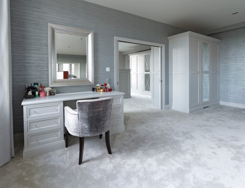 contemporary powder room white vanity table light grey vanity chair with darkwood legs white framed vanity mirro light grey walls whitewashed concrete floors