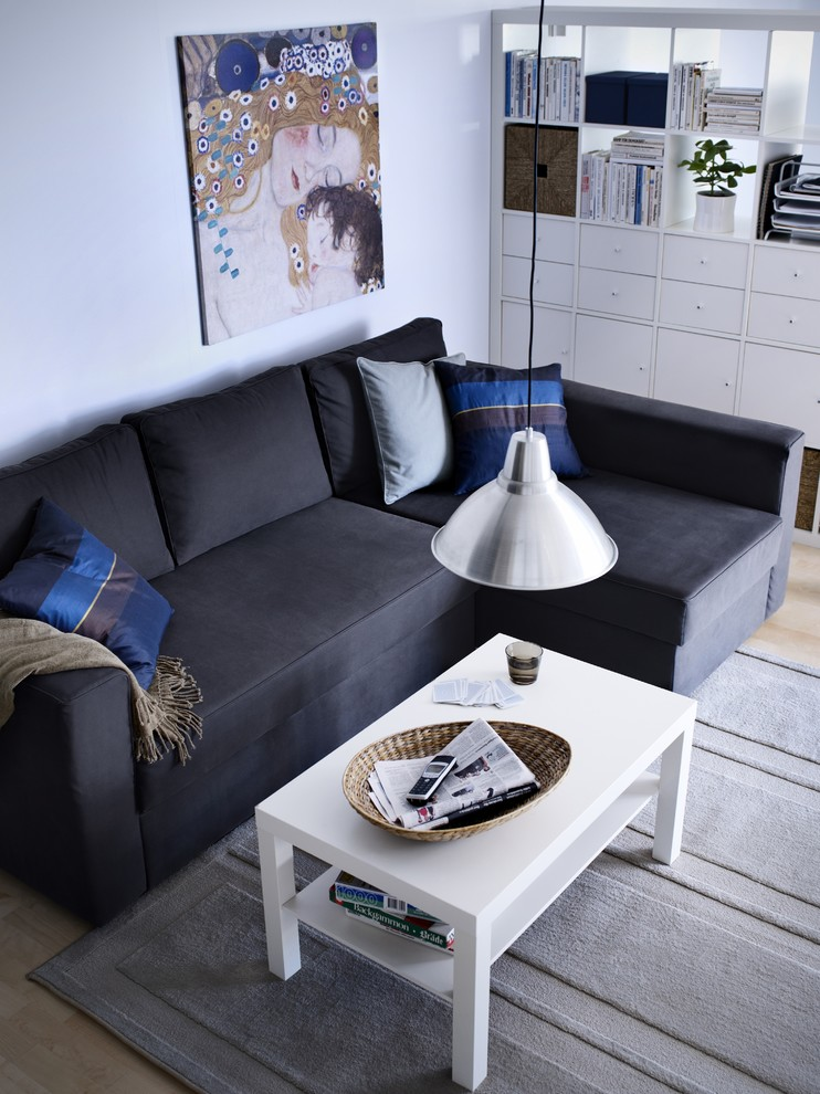 corner sofa with bed and storage addition multicolored accent pillows rectangular shaped coffee table in white grey area rug silver toned pendant lamp
