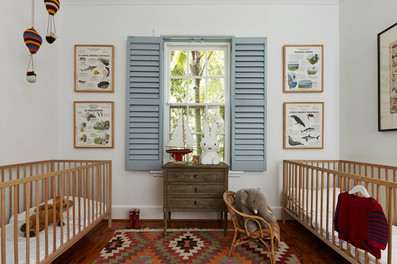 cottage chic nursery idea wood cribs rustic feel side table tribal rug in multicolors dark toned wood floors baby blue window shutter for interior
