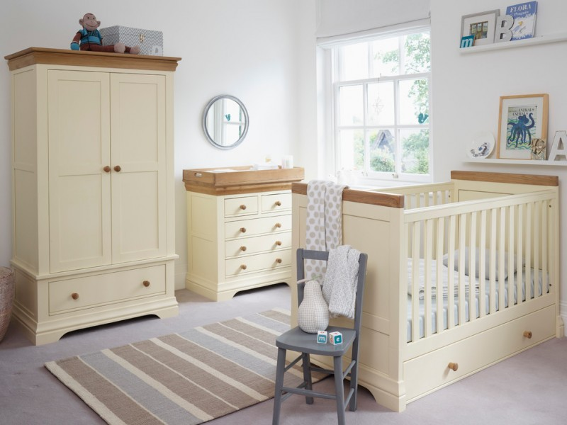 country nursery idea for cottage house light cream closet storage cream changing table with wood colored top cream baby crib with wood accents soft stripped area rug in middle size