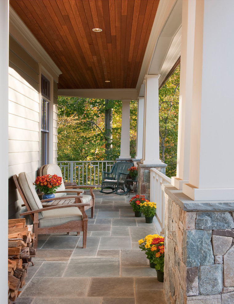 craftsman front porch idea a couple wood chairs with wood side table corner dark chair concrete tiles floors