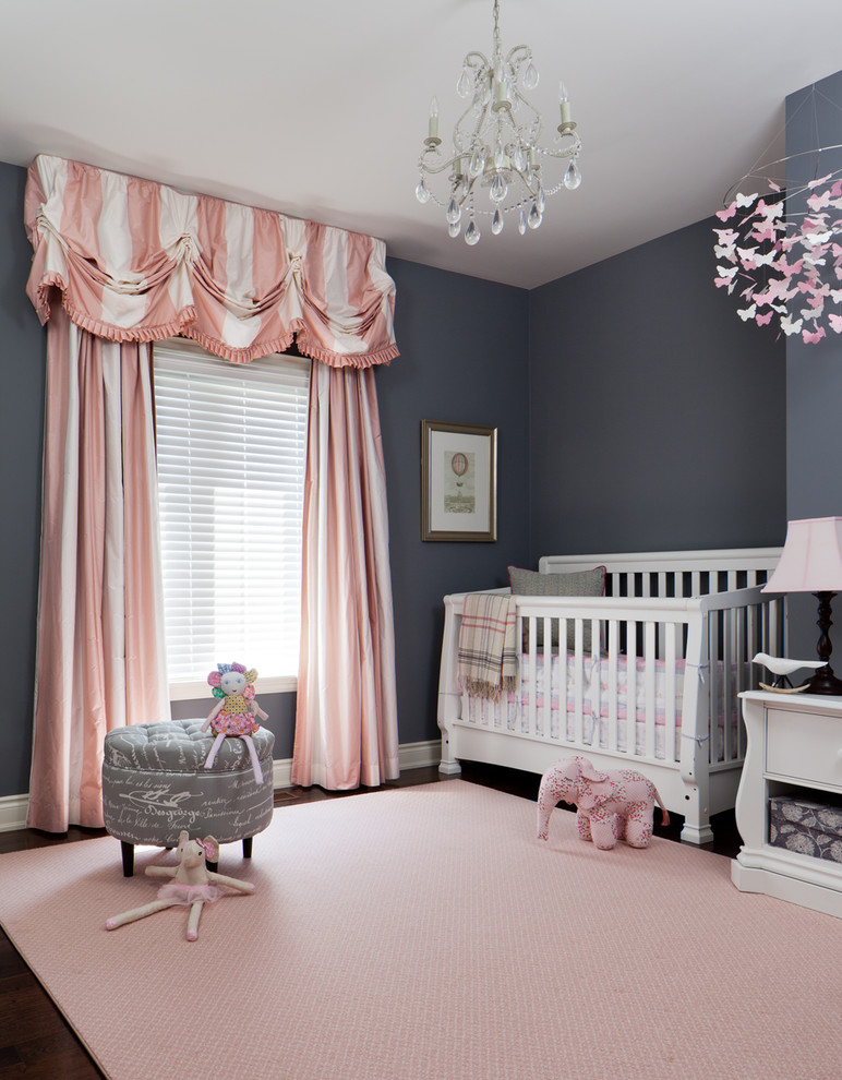 dark grey walls stripped white blush pink window curtains with decorative top white baby crib blush pink rug light grey side chair