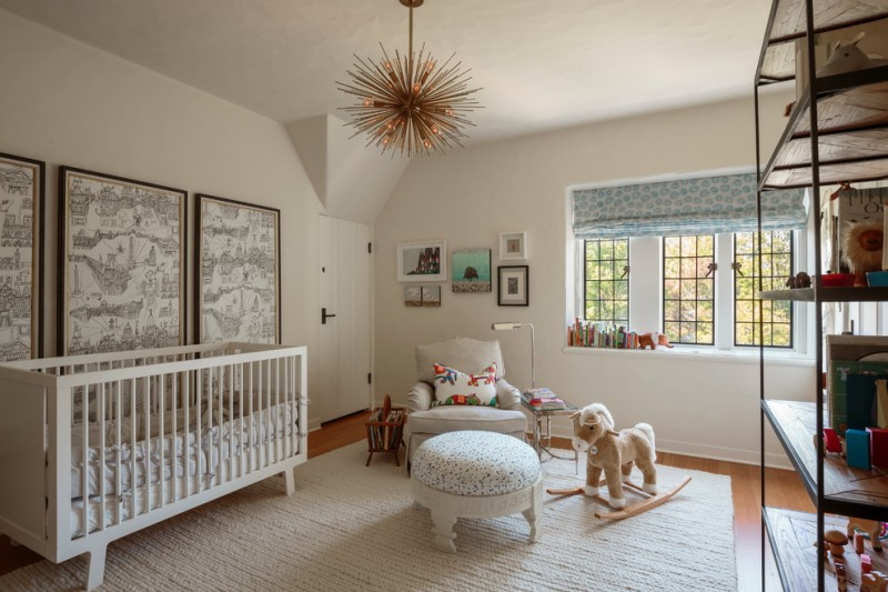 dominant white nursery idea white rug with texture white nursery chair with multicolored accent pillow white round top table with blue accents pull up window curtain with blue accents white baby crib