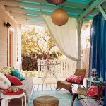 Eclectic Front Porch Idea Handcrafted Seats With Colorful Throw Pillows Small Sized Rug In Blue White Side Table With White Round Top Oriental Lanterns Semi Transparent Draperies