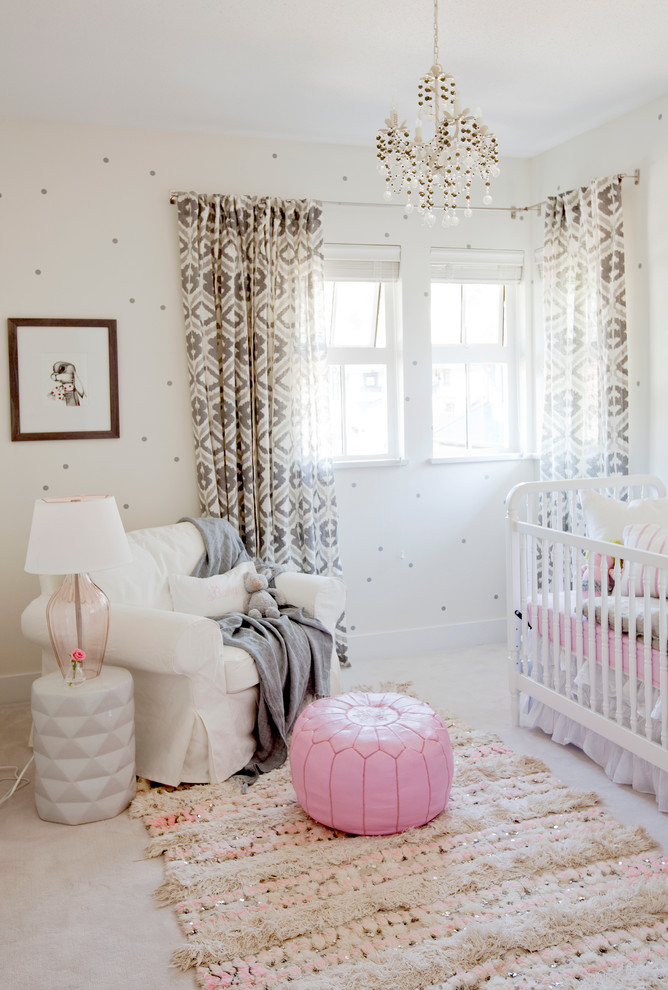 eclectic nursery idea soft and thick rug pink pouf white nusery chair slipcover white side table with table lamp white crib window curtain with dark patterns
