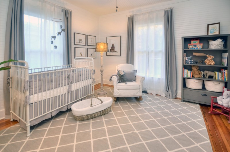 farmhouse nursery idea grey rug with white line accents white nursery chair medium toned wood floors white baby crib white walls grey window curtains with white sheer traditional floor lamp