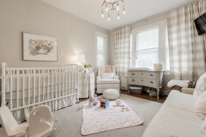farmhouse style nursery idea light grey walls white area rug white cotton rug with multicolored polka dots motifs large sized crib in white white nursery chair white changing table in white