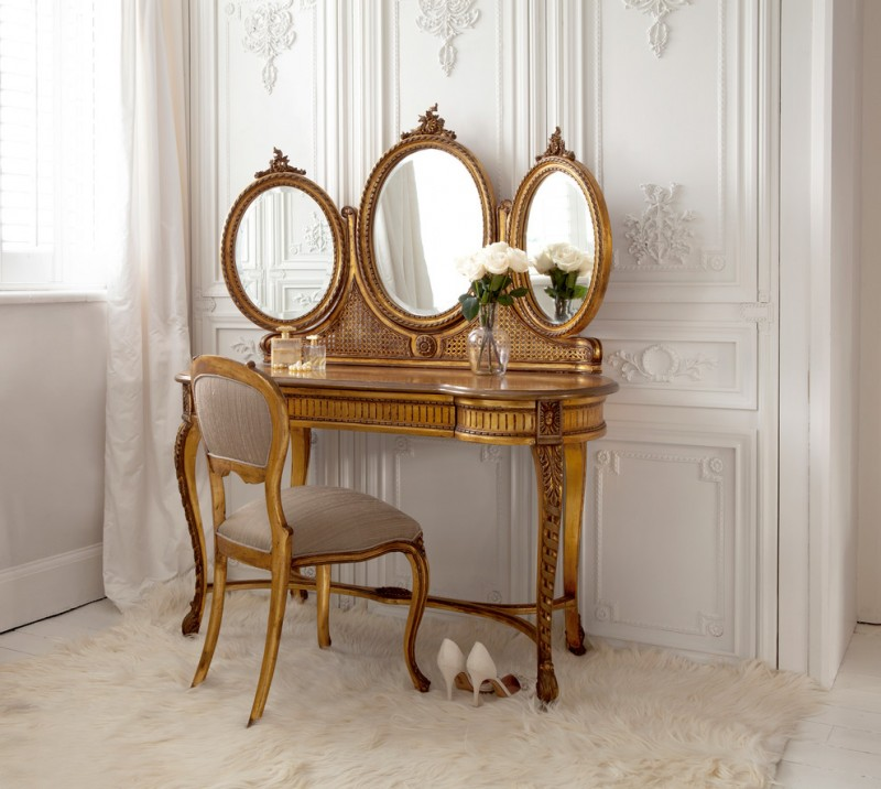 gold finishing antique French style dressing table with three mirrors and vanity chair white shag rug