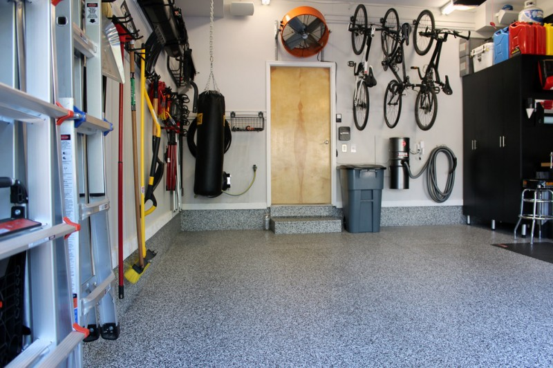 industrial garage idea light toned wood garage door grey epoxy coating floors wall mounted bike racks black finishing closet