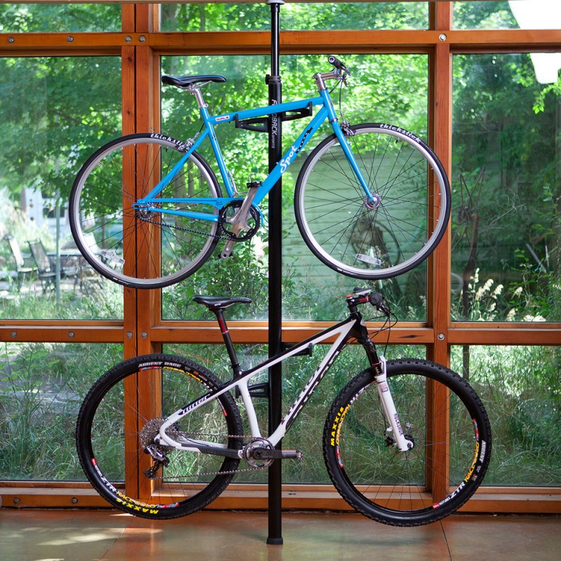industrial style living room with hanging bike display rack
