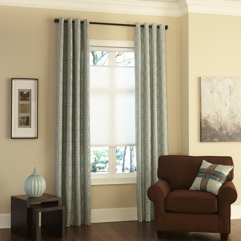 light blue window curtains with white motifs black stained curtain rod white window shade brown corner chair with pillow layered side tables in dark brown