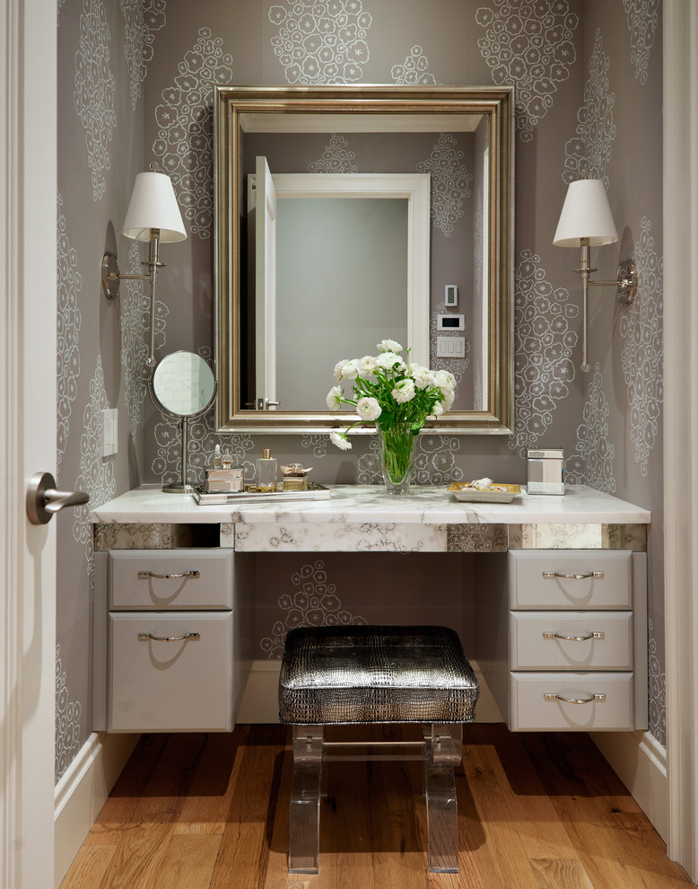 marble top dressing table with drawer system and separated chrome framed mirror a couple of traditional wall lamps gloss top vanity chair with clear acrylic base
