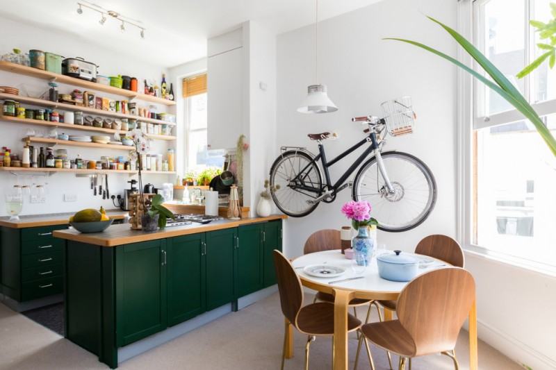 modern eat kitchen with unique wall bike decor lightweight wood dining furniture in modern style dark green cabinets shaker cabinets wood countertop