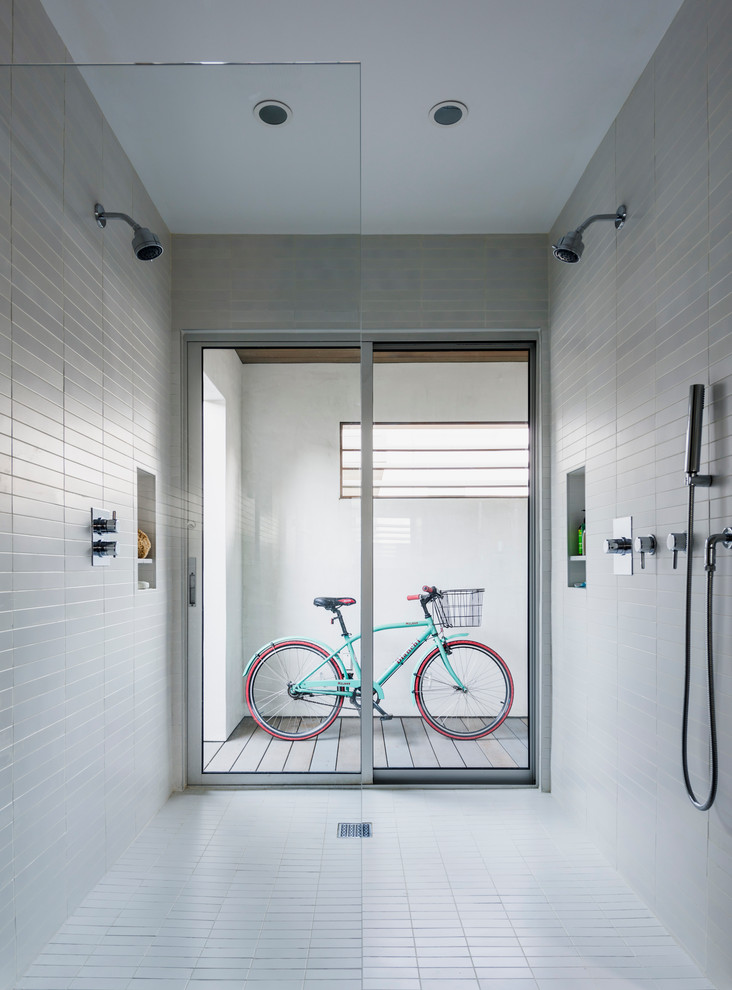 modern minimalist entry way in all white standing bike storage idea