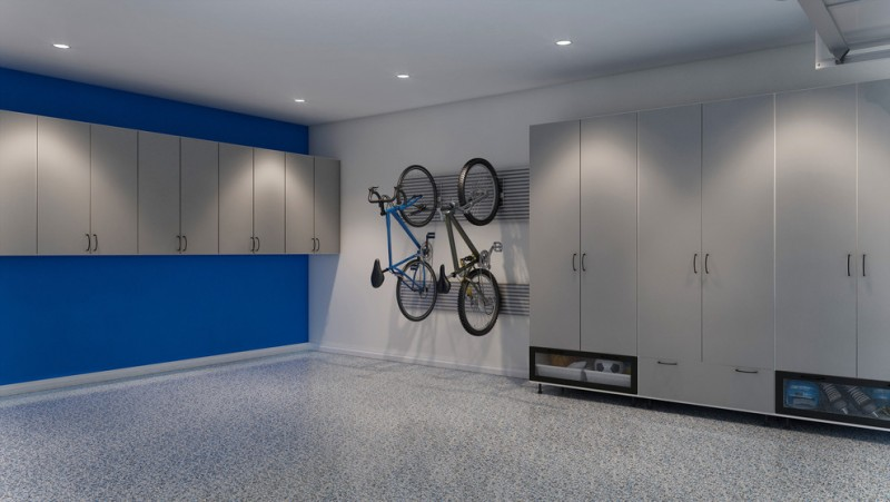 modern minimalist garage idea grey laminate cabinets and closet blue laminate walls wall mounted bike racks grey Epoxy coating floors