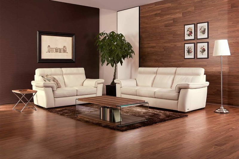 modern sleeper sofa in white wood top coffee table dark toned wood floors wood walls modern floor lamp x base side table