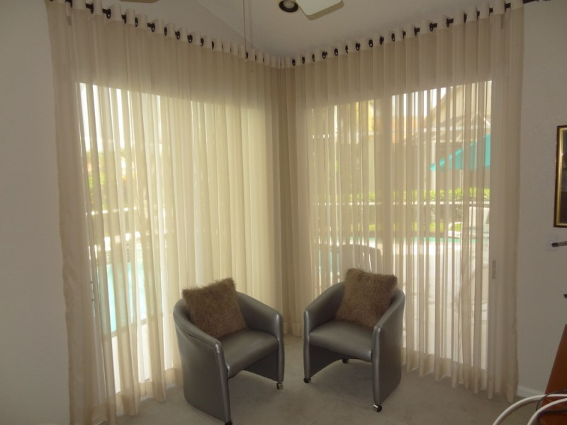 modern window sheer for basement a couple of grey chairs with brown fury accent pillows