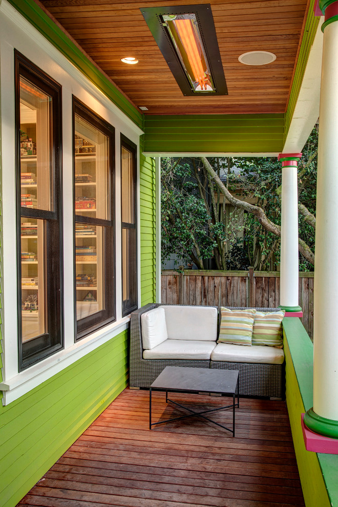 narrow front porch with modern seating green exterior walls green railing system buikt in ceilings with recessed lamps