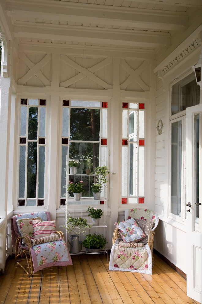 narrow porch idea chair slipcovers in vintage style ladder rack for plants corner window with clear red accents on corners and opaque center