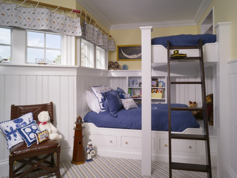neutral gender kids bedroom idea mustard walls with white siding baseboard bunk bed in wjite with dark wood ladder multicolored wool carpet leather corner chair with animal stuff