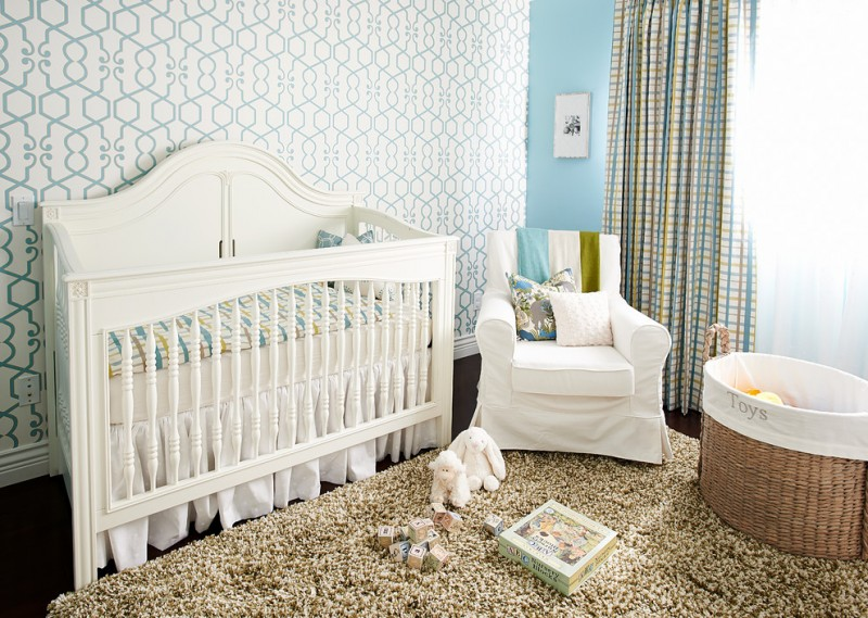 nursery for baby boys traditional white crib white nursery chair slipcover throw pillows basket for storage nursery rug looks like beach sand wall with blue wallpaper