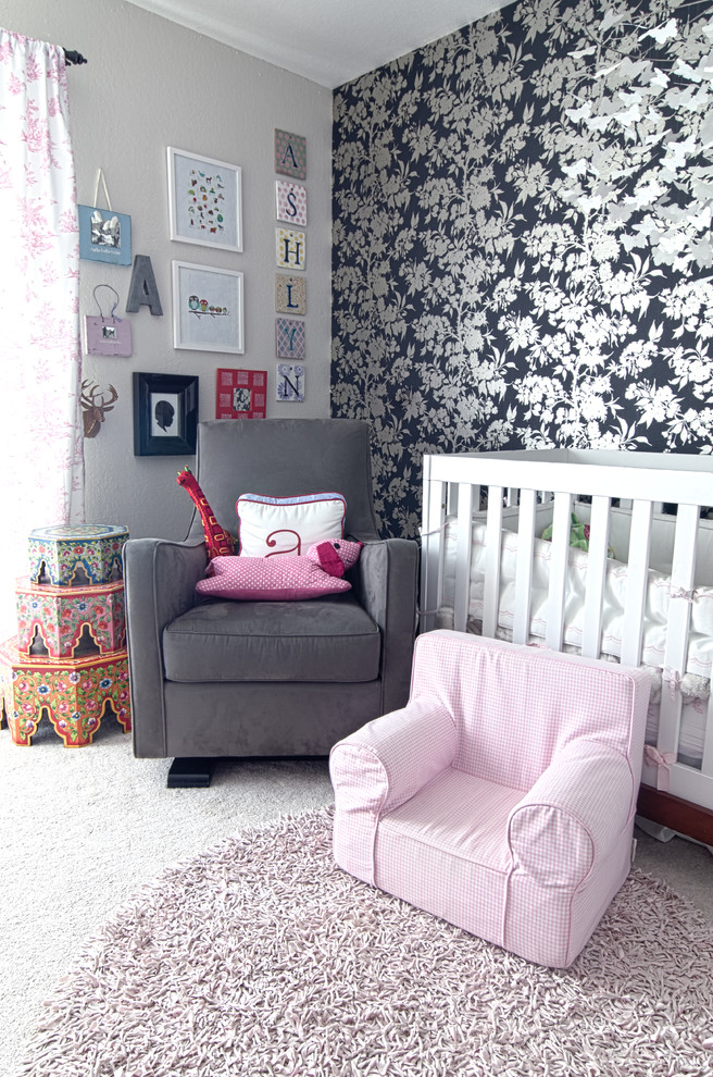 shabby chic nursery for baby girls white black wallpaper with floral motifs white crib baby pink chair in small size dark grey nursery chair round shape rug in baby pink light grey walls