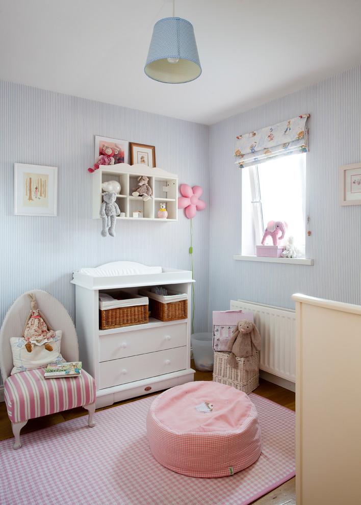 shabby chic nursery idea baby pink rug round shaped cotton pouf in baby pink small chair with pink accents white changing table with storage underneath light blue walls
