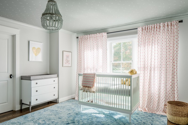 simple nursery idea white walls blue area rug beautiful window curtains with red polka dots white baby crib vintage changing table in white