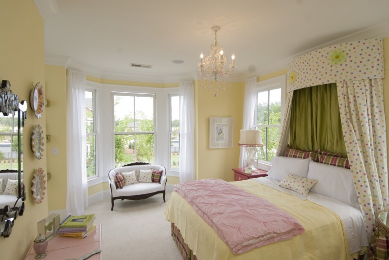 traditional bedroom design mustard walls traditional loveseat with throw pillows mustard blanket pink quilt polka dots bed curtain
