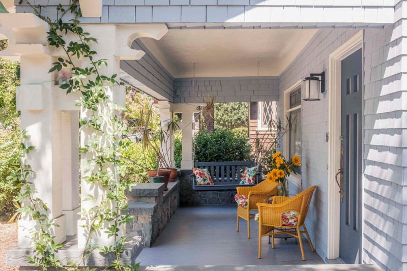 traditional front porch idea wood colored chairs with vintage style seating pad hanging settee in grey