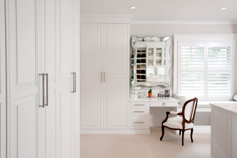 traditional walk in closet in white integrated dressing table with waving edged vanity mirror traditional white vanity chair with wood panels