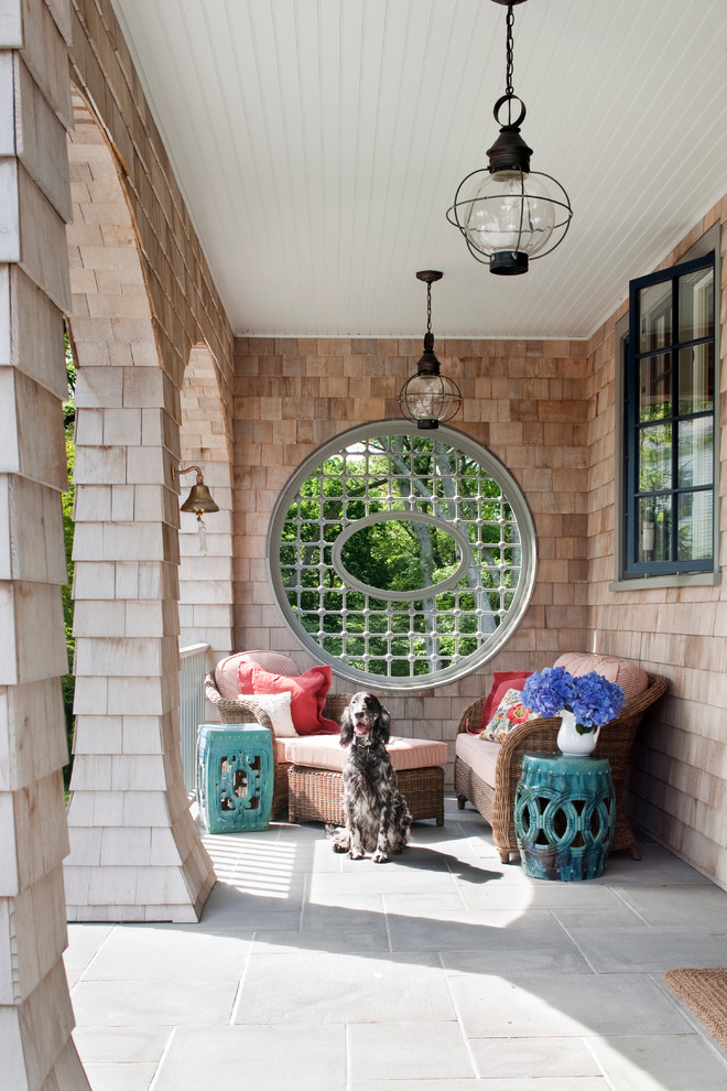 unique front porch with round decorative window seats shabby turquoise side tables shingles walls