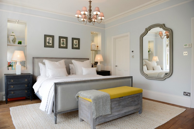 victorian bedroom idea grey upholstered bed frame grey bed seat with mustard top pale blue walls antique mirror antique pendant lamp dark blue bedside tables with drawer system white knitted area rug