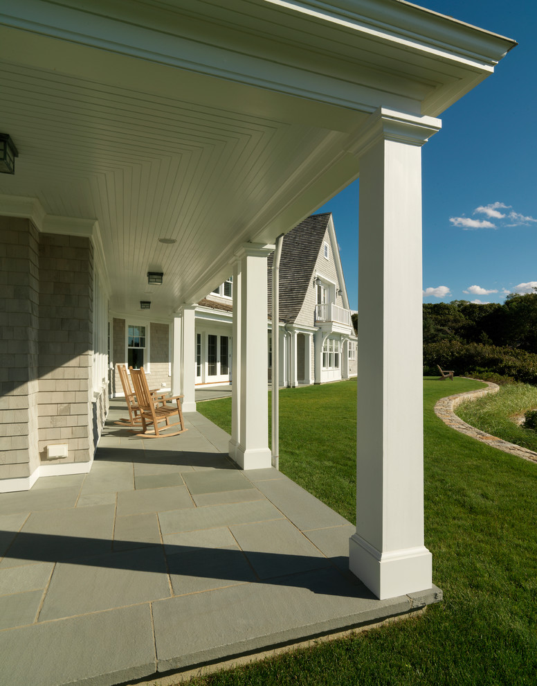 victorian front porch idea large concrete tiles floors huge exterior pillars in white grey exterior walls wood rocking chairs white siding ceilings
