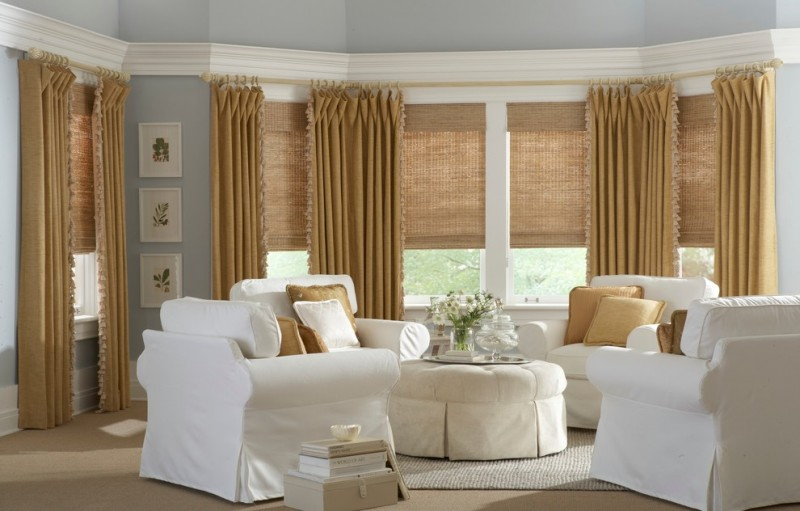 wood woven window shades light brown window curtains with fury details white chair slipcovers light beige carpet light blue walls