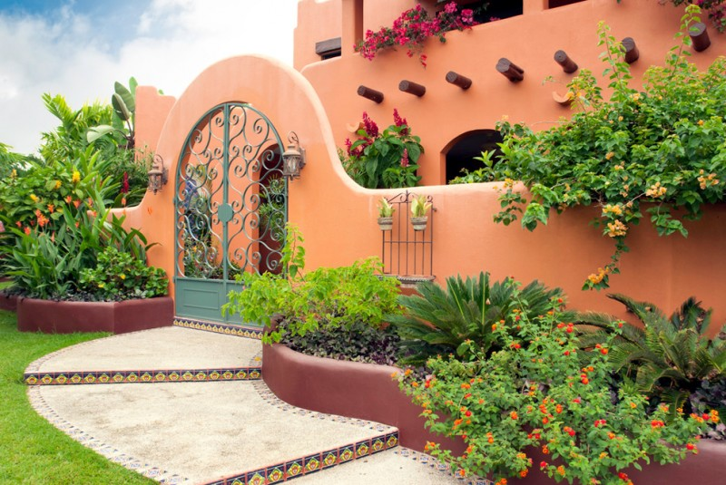 Mediterranean landscape and exterior arched gate in orange