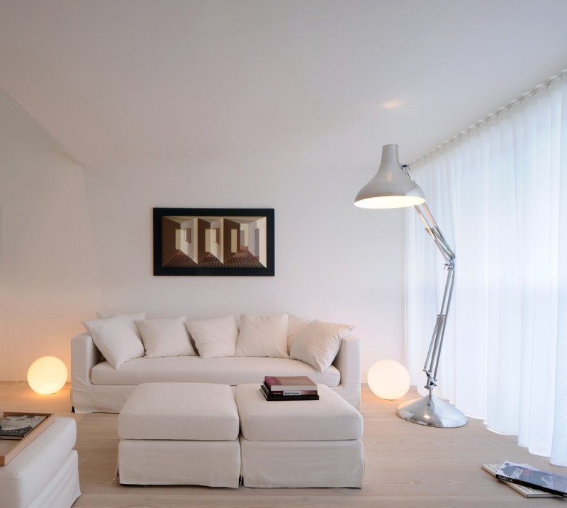 all white scandinavian living room white sofa slipcover white accent pillows metal floor lamp a pair of floor bulb light fixtures