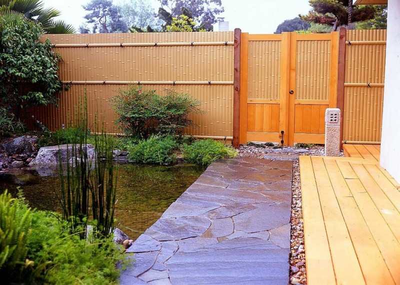 asian landscape bamboos fence trimmed with cedar wood decking floors stone floors