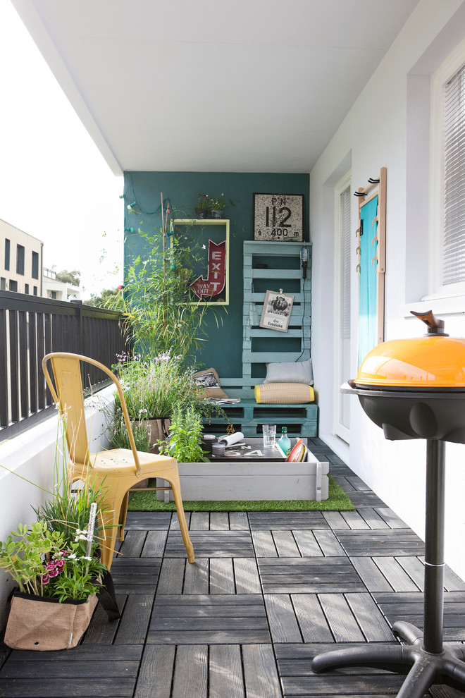 clean lines balcony paving floors blue ocean painting walls metal rails with concrete base