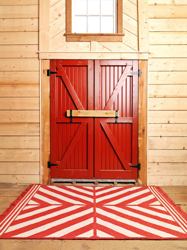 colonial entry door idea with stripes and textured red white red front rug with strip motifs