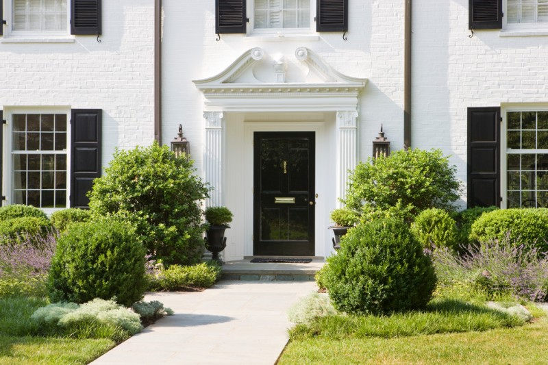 colonial style exterior in white black finishing front door large wall sconces for exterior