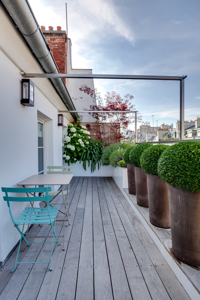 contemporary balcony idea well arranged planters with herbs shabby wood decking floors clean white exterior walls modern furniture set